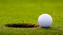 Golf-ball-on-edge-of-hole-jpg